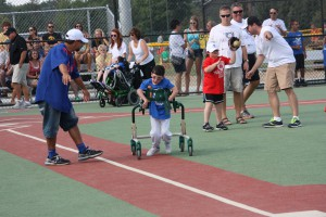 boy running bases miracle league