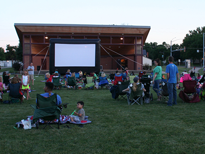 patrons at Movies Under the Stars at the Bandshell at Wagner Park