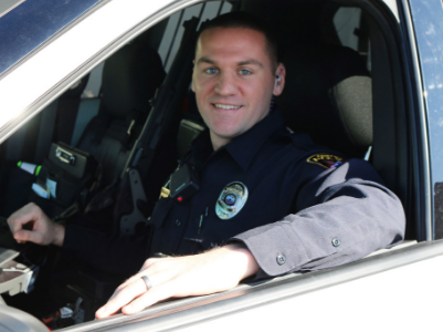 male officer in vehicle
