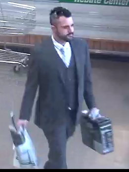 suspect 19-003433 male in suit with beard, mohawk