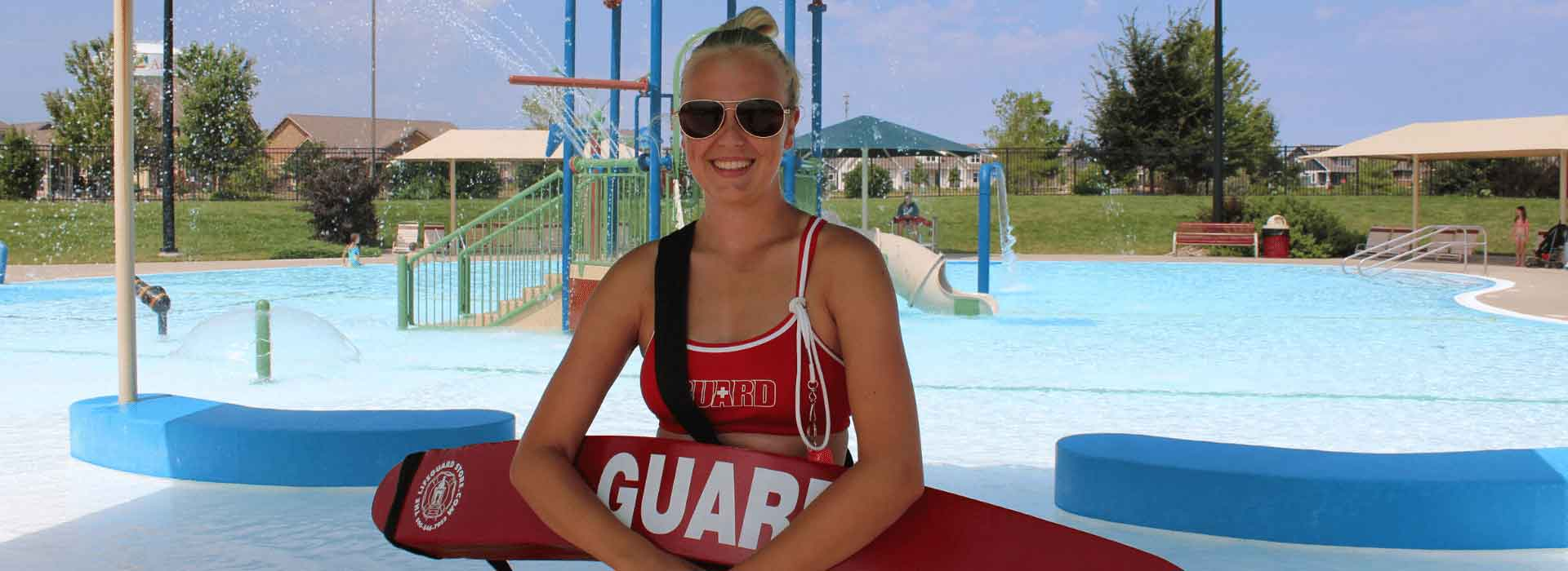 female-lifeguard-in-front-of-zero-entry-pool