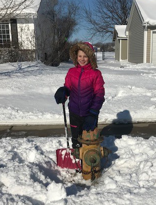 Pluggies Partner, girl clearing snow around fire hydrant